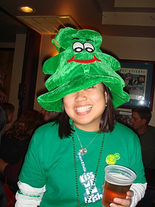 Jackie with the Shamrock Hat, a Gaelic Storm t-shirt and a pint of Harp.  I miss my home!