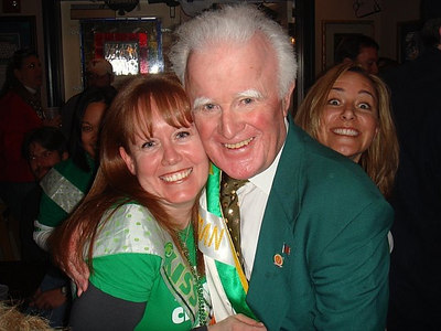 Pat Troy, owner of Pat Troy's Irish bar, with Sonia and Kristin peaking over Mr. Troy's shoulder.