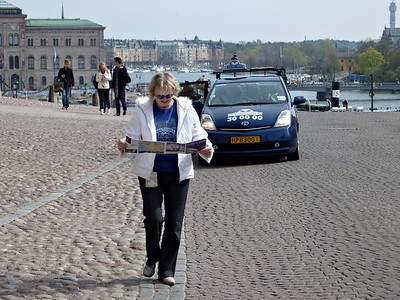 Pat near the Royal Palace, with a map she's found on the cobbles.