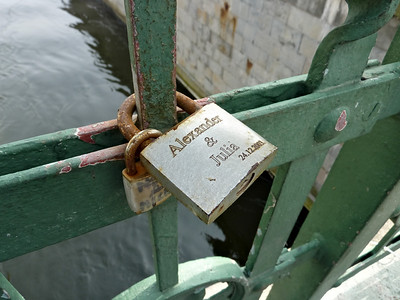 Couples attach padlocks to bridges like this one that connects the palace area to Gamla Stan.