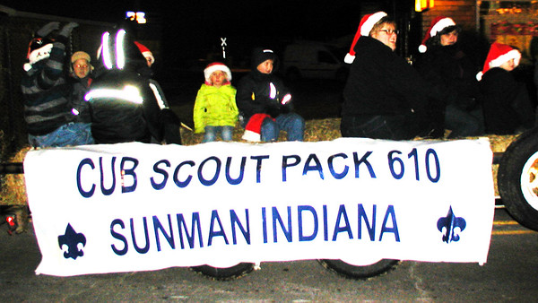 Diane Raver | The Herald-Tribune<br /> Cub Scouts ride on a wagon in the parade.