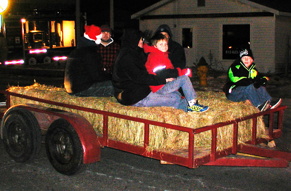 Diane Raver | The Herald-Tribune<br /> Some folks traveled on trailers in the parade.