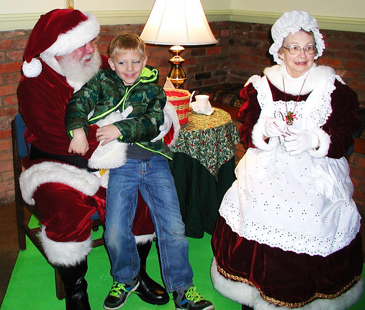 Diane Raver | The Herald-Tribune<br /> Mason Metcalf, 8, Sunman, talks to Santa and Mrs. Claus.