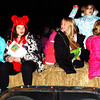 Debbie Blank | The Herald-Tribune<br /> Girl Scouts were happy to be a part of the 6 p.m. parade with a Christmas theme.