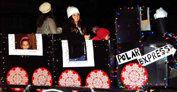 Debbie Blank | The Herald-Tribune<br /> George's Pharmacy families decorated a float with a Polar Express theme.