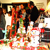 Debbie Blank | The Herald-Tribune<br /> Christmas decorations were for sale at one of 22 booths inside the American Legion hall. Upon arrival after the parade, many families immediately got in line to chat with Santa and Mrs. Claus.