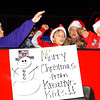 Debbie Blank | The Herald-Tribune<br /> Santa hats and candy were on board the Kreative Kids vehicle.