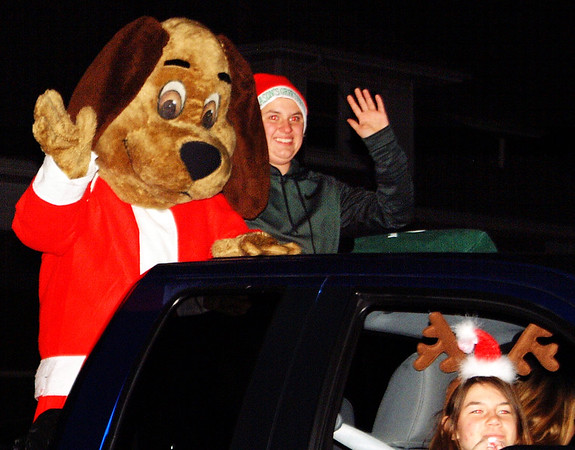 Debbie Blank | The Herald-Tribune<br /> A dog in festive attire always is welcome in a holiday parade.