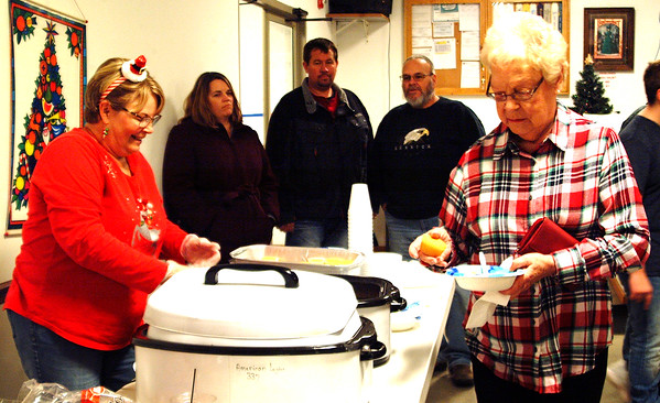 Debbie Blank | The Herald-Tribune<br /> Soup and corn bread sounded good to Shirley Campbell (right). She was served by Carla Hacker, who helped organize Sunman Celebrates the Season.