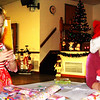 Debbie Blank | The Herald-Tribune<br /> Even though the American Legion hall was mobbed with folks checking out 22 booths and in line to visit Santa, Addyson Jenkins (left), 4, Batesville, and Landon Craft, 3, Sunman, found a quiet corner in which to color.