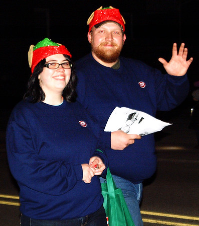 Debbie Blank | The Herald-Tribune<br /> Sunman IGA cashier and deli clerk Tresa Simon (left) and night shift manager Eric Hudepohl Jr. make friends while passing out treats along the parade route.