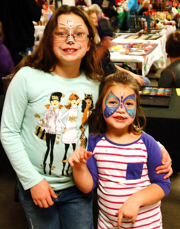 Debbie Blank | The Herald-Tribune<br /> Sisters Savanna (left), 11, and Evelyn Guinn, 4, Harrison, Ohio, were thrilled with their painted faces.