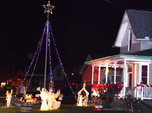 Debbie Blank | The Herald-Tribune<br /> The festive home at 316 Eastern Avenue welcomed parade participants. Owner Judy Schmidt decorated outside with the assistance of grandson Jaylon, Indianapolis.