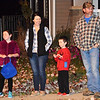 Debbie Blank | The Herald-Tribune<br /> Cincinnati transplants Joe and Tonia Riesenbeck, who just moved to Sunman, enjoy the procession with daughter Heidi, 8, and son Joey, 5.