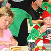 Debbie Blank | The Herald-Tribune<br /> Sisters Traci Kurtz (left), Preble County, Ohio, and April Bruns, Sunman, who was on the George's Pharmacy parade float, eat supper at the American Legion hall.