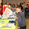 Debbie Blank | The Herald-Tribune<br /> Sebastian Hall, 8, Sunman, checks out the wares at booths at the American Legion hall. Santa and Mrs. Claus were chatting with children in a separate room that was quieter. The boy said his favorite part of Sunman Celebrates the Season was seeing Santa in the procession.