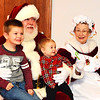 Debbie Blank | The Herald-Tribune<br /> Santa and Mrs. Claus learned the Christmas wishes of Cameron, 4, and Ava, 10 months. Their parents are Nick and Amber Scholl, Sunman. Sunman Celebrates the Season sponsored by the Sunman Area Chamber of Commerce started with a parade and ended at Kenneth L. Diver American Legion Post 337, where families could visit the merry couple, eat and shop Friday, Nov. 18.
