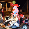 Debbie Blank | The Herald-Tribune<br /> A snowman and smiling girls were part of the Tiers & Cheers Cake Shop float.