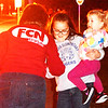 Debbie Blank | The Herald-Tribune<br /> An FCN employee hands treats to Kailyn, 9, and Olivia, 2, daughters of Robert and Kati Stanley, Sunman.