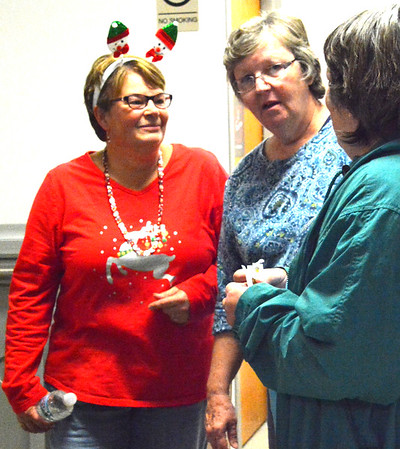 Debbie Blank | The Herald-Tribune<br /> Carla Hacker (left) chats with friends after the parade. Hacker and Sunman Clerk-Treasurer Chelsea Eckstein planned the fourth annual Sunman Celebrates the Season.