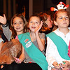 Debbie Blank | The Herald-Tribune<br /> Girl Scouts in Troop 49010 wave to the crowd lining Eastern Avenue.