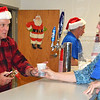Debbie Blank | The Herald-Tribune<br /> Legionnaire Denny Larkins (left) serves a drink to Jane Werner, who was on the St. John United Church of Christ, Penntown, float.