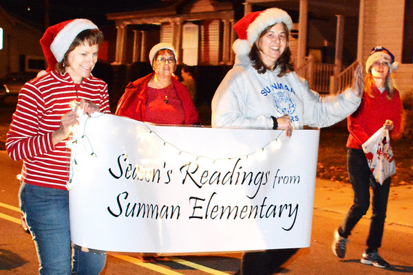 Debbie Blank | The Herald-Tribune<br /> Sunman Elementary School teachers promote the benefits of reading during the procession.