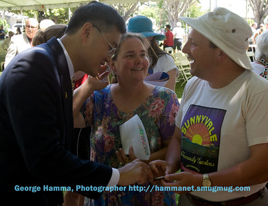 Mayor Otto Lee with Laurie Hughes and Josh Salans representing the Charles Street Garden.