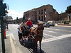 ANOTHER HORSE DRAWN CARRIAGE WITH THE COLOSSEUM IN THE BACKGROUND
