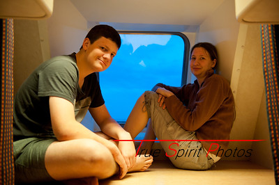 "Claire & Jonathan sitting in the port hole area in our cabin on the Ferry trip across the ""Bass Strait"" on the ""Spirit of Tasmania"" which took almost 12 hrs. Very glad we took the option ( thanks Karen) of a cabin as this gave us an overnight sleep in a bed."