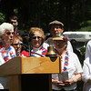 """Tewksbury Memorial Day ceremony at Tewksbury Cemetery. Arlene Wright and the Tewksbury Swinging Seniors sing """"God Bless America"""" to conclude the ceremony. (SUN/Julia Malakie)"""