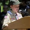 """Tewksbury Memorial Day ceremony at Tewksbury Cemetery. Ian Gray, 11, of Tewksbury, a member of Boy Scout Troop 322, reads the poem """"In Flanders Field."""" (SUN/Julia Malakie)"""