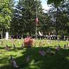 Flag at half staff during Tewksbury Memorial Day ceremony at Tewksbury Cemetery.  (SUN/Julia Malakie)