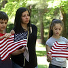Tewksbury Memorial Day ceremony at Tewksbury Cemetery. Denise Roche of Tewksbury with son Mikey Roche, 10, and daughter Emma Roche, 12, listen to ceremony. Roche said it's been ten years since her husband, who served in Iraq and Afghanistan, died from service-related injuries, and they've been coming to the Memorial Day event ever since.  (SUN/Julia Malakie)