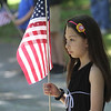 Jada Diaz, 8, of Tewksbury, at Tewksbury Memorial Day ceremony at Tewksbury Cemetery.  (SUN/Julia Malakie)