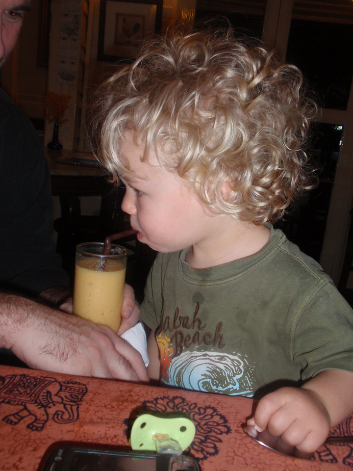 "Dash endulging in his first mango shake.  As at every meal, we had the pacifier (or ""dummy"" as we like to call it) at the ready."