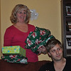 Let the Thankmas festivities begin.  Linda distributes the gifts, with Wes' help.