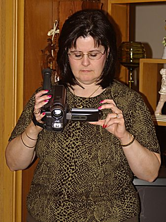 "<font size=""3"">Susan with her camera.</font>"