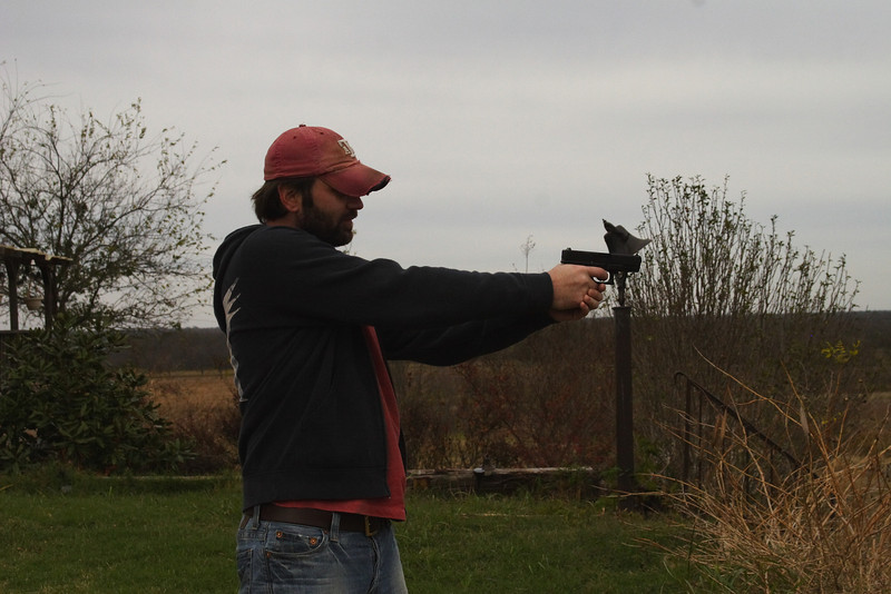 Manny shooting the glock.