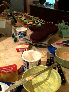The kitchen during the cupcake making process.