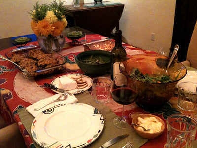 Thanksgiving Dinner 2009 Panko-stuffed portabellos, Budin de elote (traditional corn pudding), sugar peas, Brie, Arugula salad with goat cheese, Fuyu persimmons, and pomegrate. Pouring Stag's Leap Fay 2005.