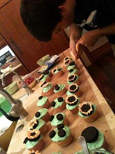 Ian making cupcakes Thanksgiving evening.