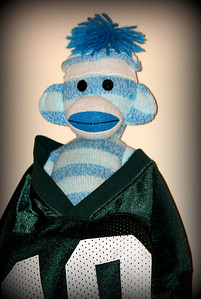 This is the good luck Sock Monkey,  He sits in the same spot waiting with his Jets Jersey for Jets games to do his magic.