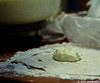 dough is rolled out and the filling is placed on the dough.