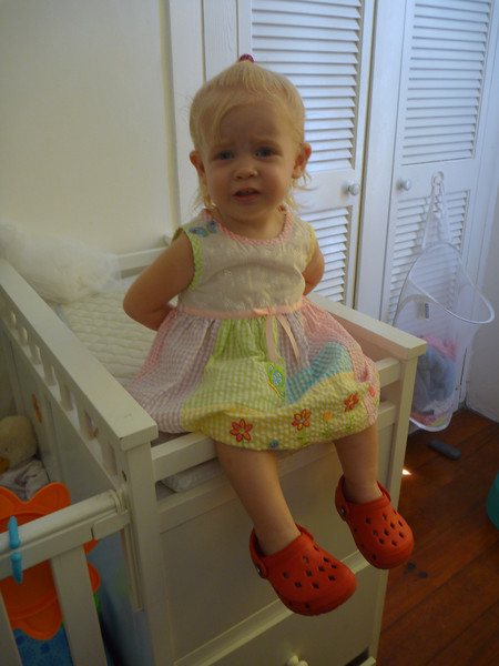 Not really sure she likes getting on her nice dress for the T-giving party...