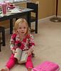 Maddie reads a big book