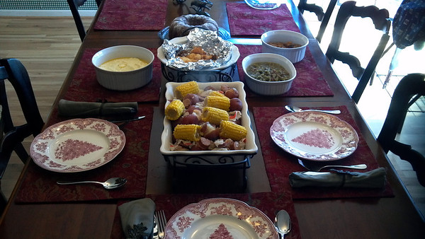 Enough food for an army.  Low Country Boil, Grits, my famous green beans, Sweet Potato Casserole, Sour Cream Cheddar Biscuits, & Chocolate Chip cake.