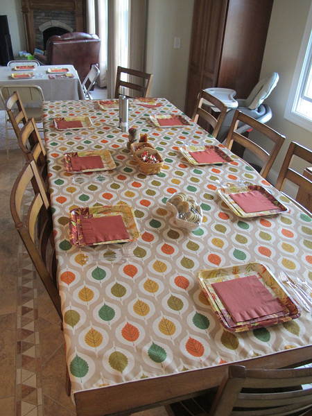 It wasn't a super fancy table, but it was nice.  We don't have enough plates and silverware to feed 14 people, so I got some cute paper plates at Wal-Mart.