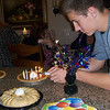 Blake lighting the 13 candles for Delaney to blow-out.