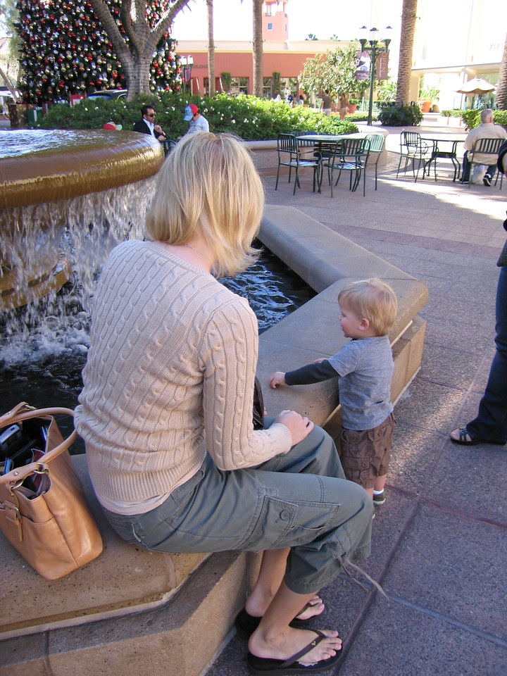 Owen and Delta, pitching pennies into a fountain